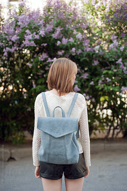Young woman with a backpack by Liubov Burakova for Stocksy United