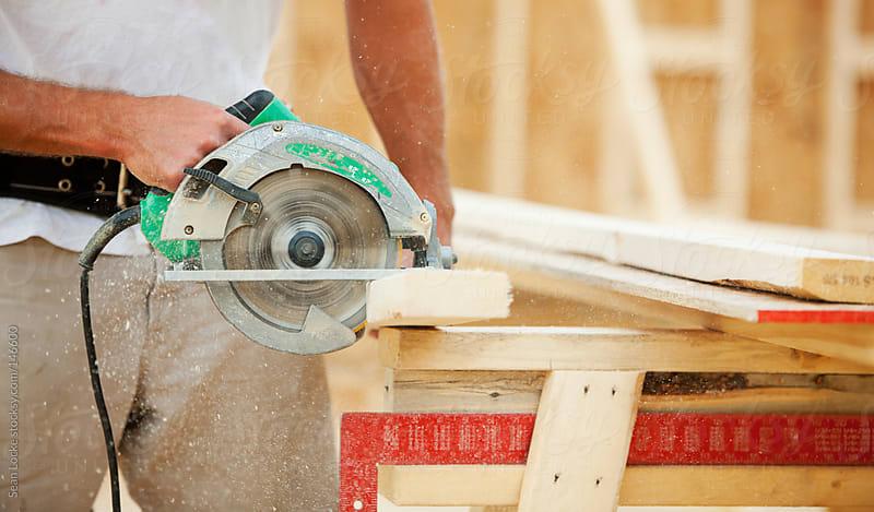 Construction: Sawdust Flies As Framer Cuts Wood by Sean Locke for Stocksy United