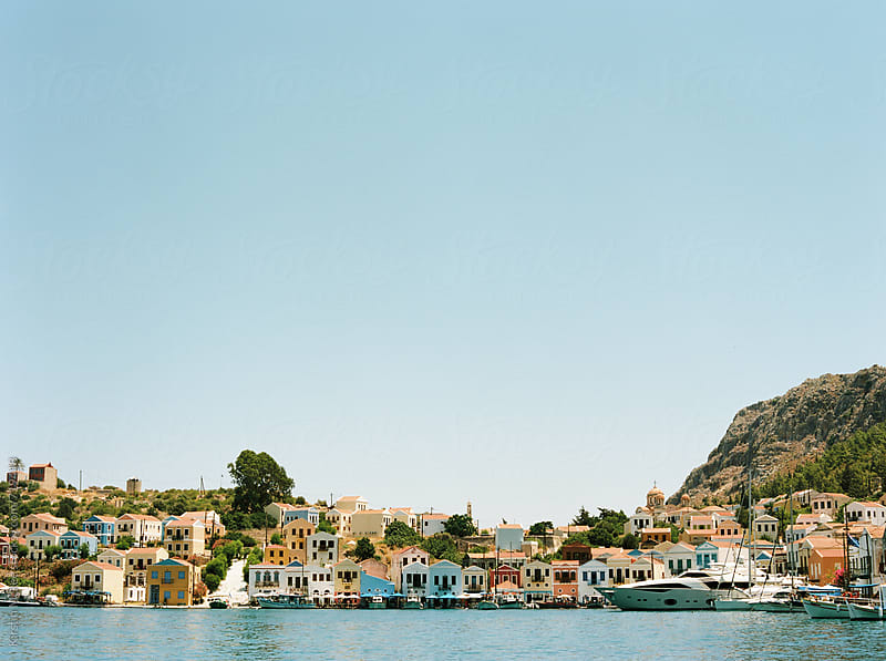 View of harbour the many coloured houses in the bay at Kastellorizo by Kirstin Mckee for Stocksy United