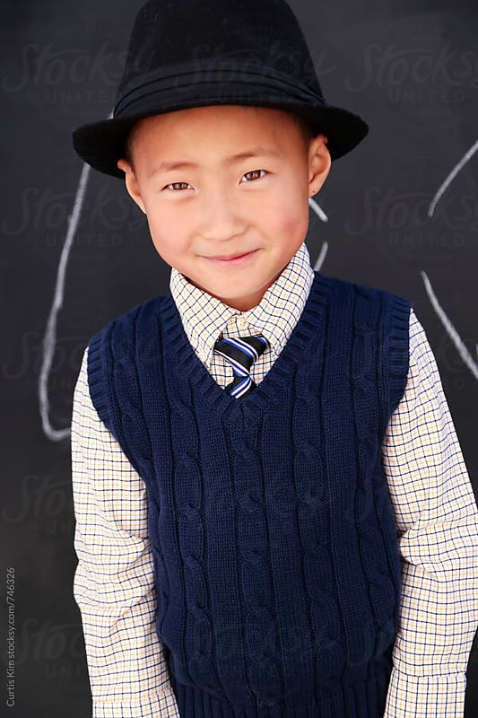 Handsome asian boy wearing a fedora hat by Curtis Kim for Stocksy United