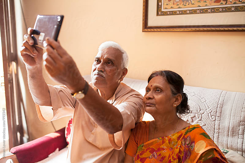 Aged Indian couple taking photograph with a Tablet by PARTHA PAL for Stocksy United