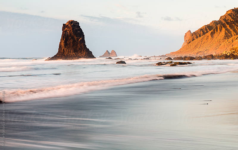 Black sand beach at sunset by Marilar Irastorza for Stocksy United