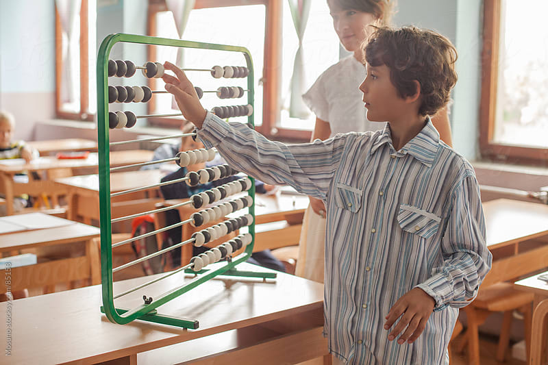 Boy Calculating on an Abacus by Mosuno for Stocksy United