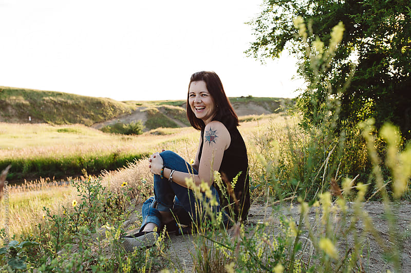 Happy Metis woman enjoying the summer landscape by Carey Shaw for Stocksy United
