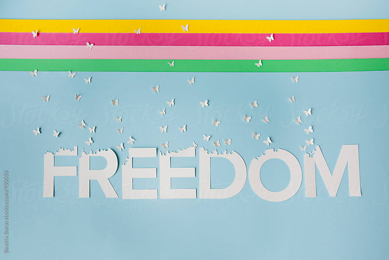 Freedom butterflies and colorful stripes by Beatrix Boros for Stocksy United
