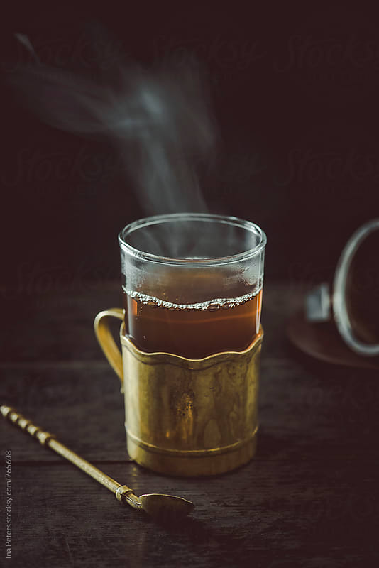 Drink: Black Tea in a glass cup by Ina Peters for Stocksy United