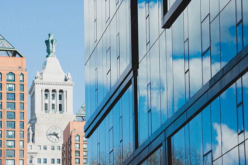Clocktower and glass building in New York City by Lauren Naefe for Stocksy United