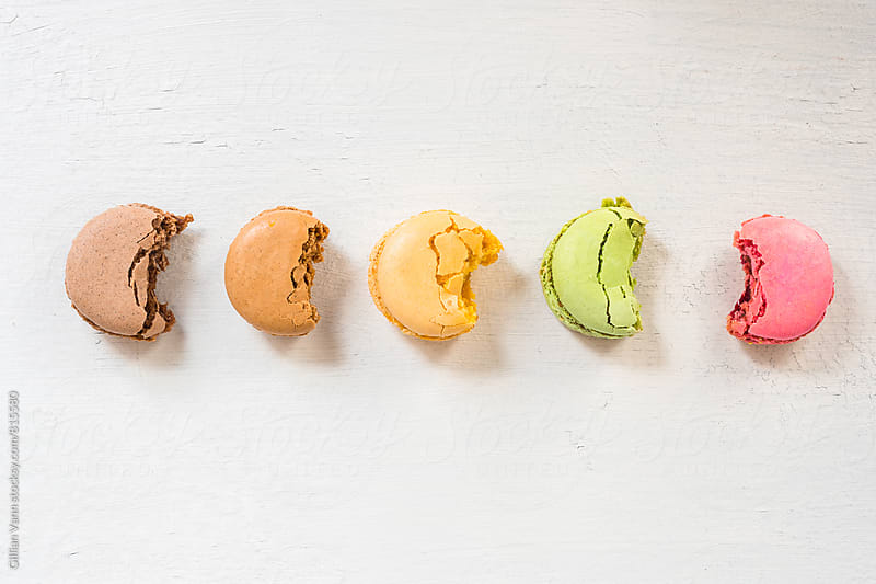 half eaten macarons  by Gillian Vann for Stocksy United
