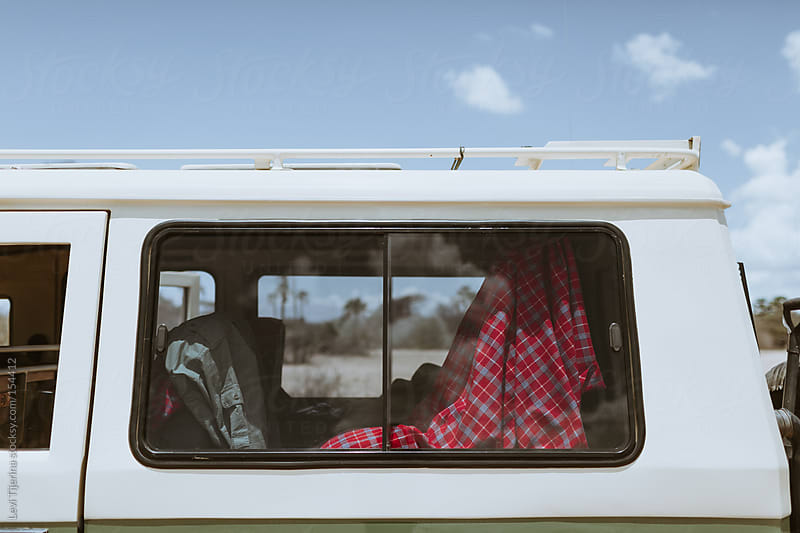 Van in the African Bush preparing for a road trip by Levi Tijerina for Stocksy United