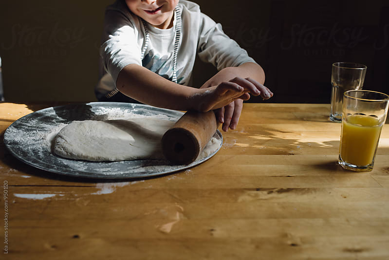 child making pizza by Léa Jones for Stocksy United