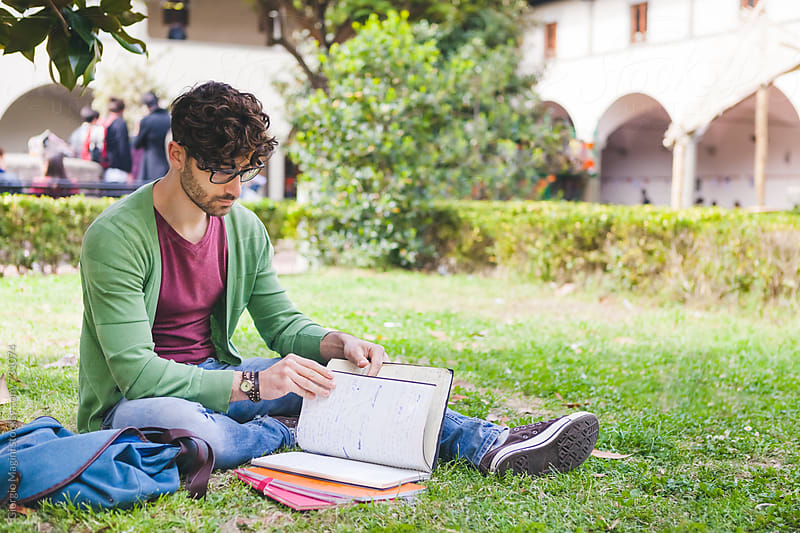 Young Man Studying Outdoors at College Campus by Giorgio Magini for Stocksy United