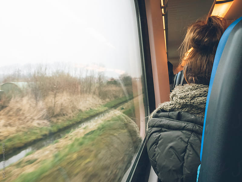 Woman sitting on the train by GIC for Stocksy United
