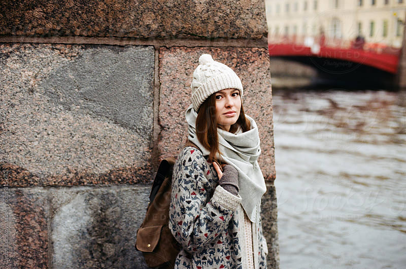 Young woman standing in front of granite wall by Lyuba Burakova for Stocksy United