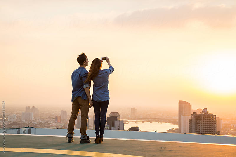 Rooftop couple selfie by Jovo Jovanovic for Stocksy United