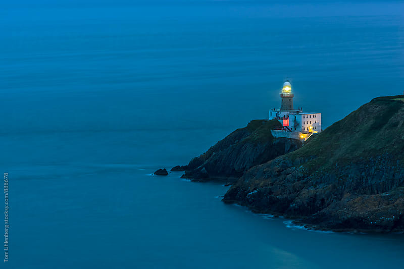 Howth, Ireland - Baily Lighthouse and Dublin Bay at Night by Tom Uhlenberg for Stocksy United