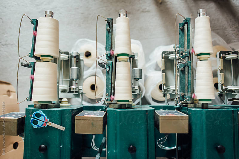 Cotton winding machine in work by Boris Jovanovic for Stocksy United
