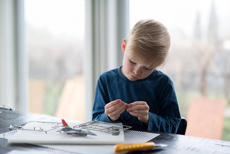 Little Boy Building Model Airplane Hobby by JP Danko for Stocksy United