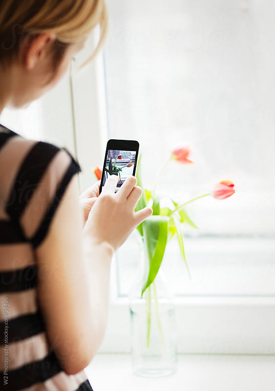 Taking photos of flowers with a Cell phone.   by W2 Photography for Stocksy United