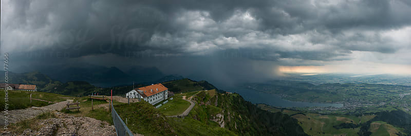 Panorama of thunderstorm from mount rigi by Peter Wey for Stocksy United