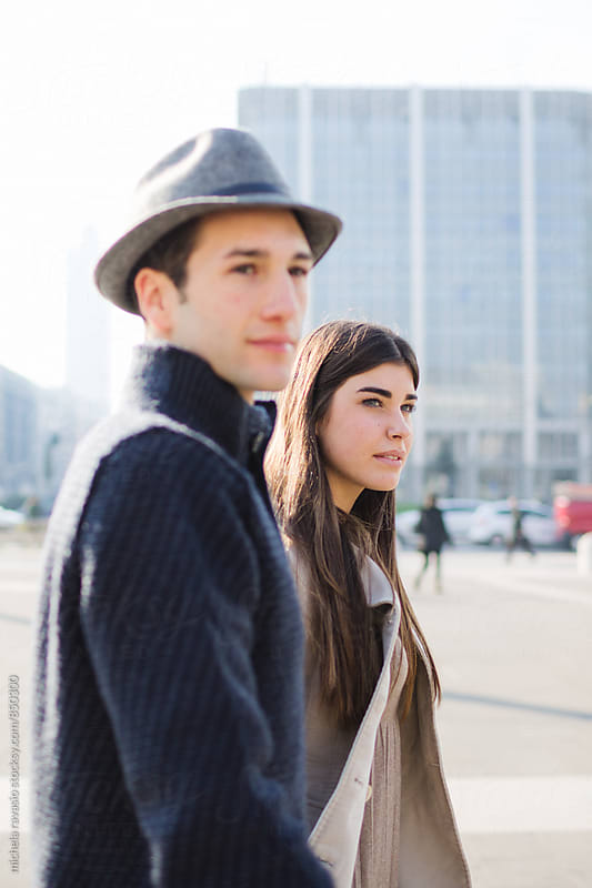Young couple walking through the city by michela ravasio for Stocksy United