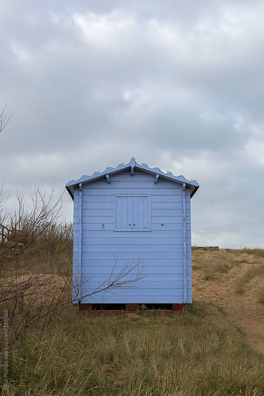 Single light blue beach hut on a sand dune by Paul Phillips for Stocksy United
