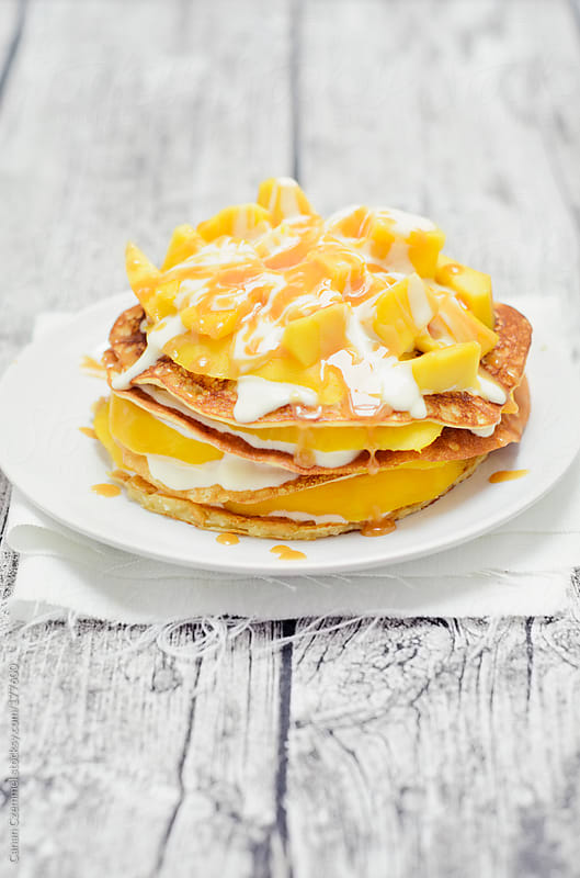 banana pancakes with mango by Canan Czemmel for Stocksy United