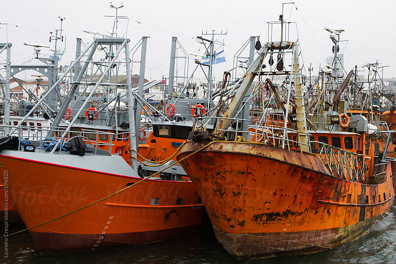 Old fisher ships in the harbour by Leandro Crespi for Stocksy United