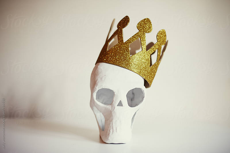Skull wearing a gold crown by sally anscombe for Stocksy United