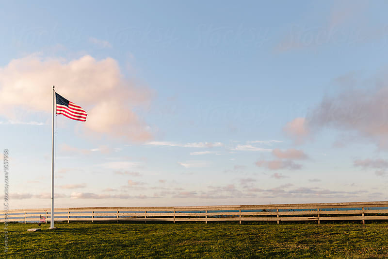 American Flag in Morning Light by Raymond Forbes LLC for Stocksy United