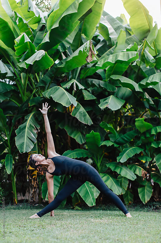 Healthy young woman doing a yoga pose outside by Jakob for Stocksy United