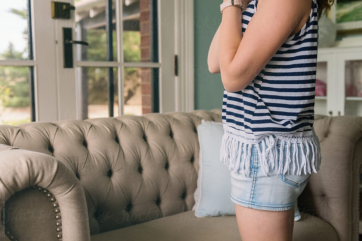 b3723340f716 Teen Girl Standing By Sofa In Living Room