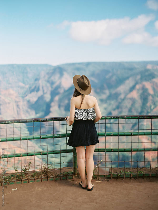 Young woman overlooking canyon by Daniel Kim Photography for Stocksy United