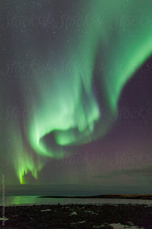 Aurora Borealis near Reykjavik by Marilar Irastorza for Stocksy United