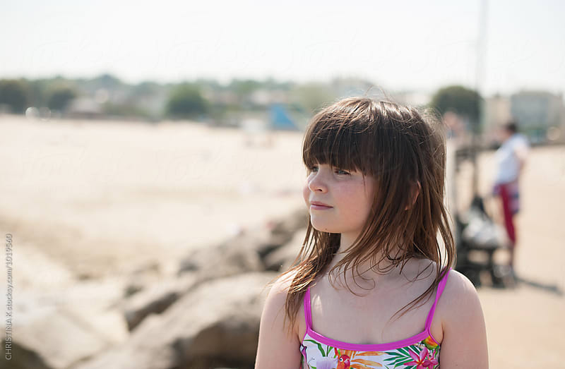 Little girl looking out to sea by Christina Kilgour for Stocksy United