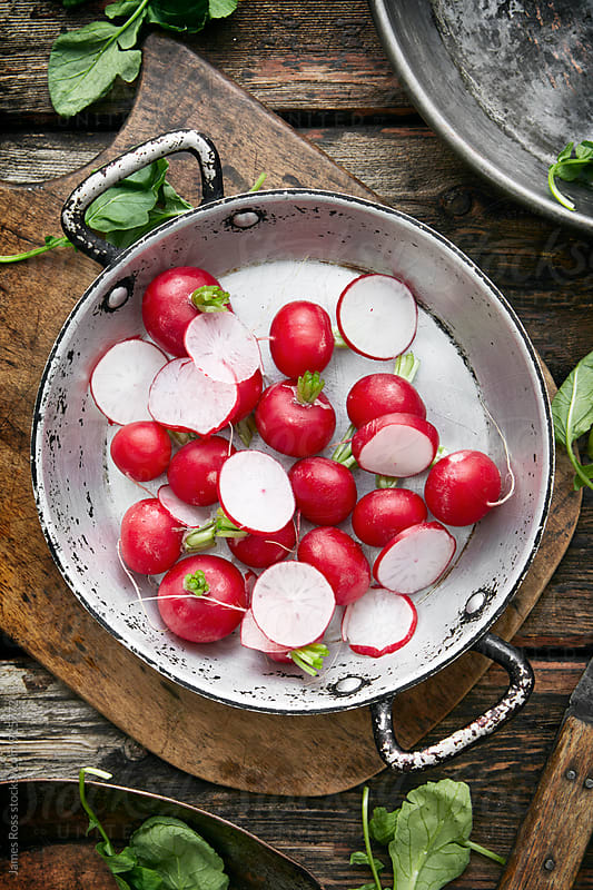 Radishes on a kitchen worktop by James Ross for Stocksy United
