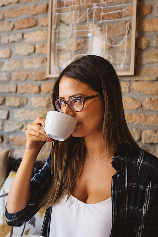 Beautiful Brunette Woman Drinking Coffee by Katarina Radovic for Stocksy United
