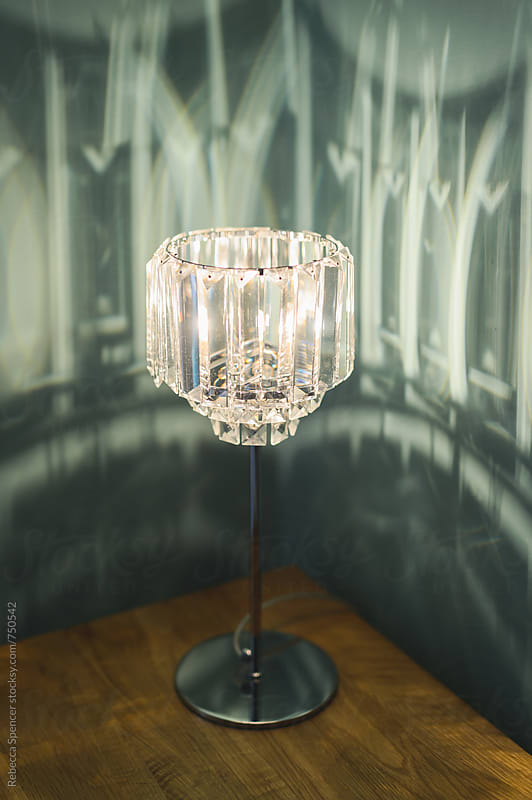 Pretty lamp on bedside table by Rebecca Spencer for Stocksy United