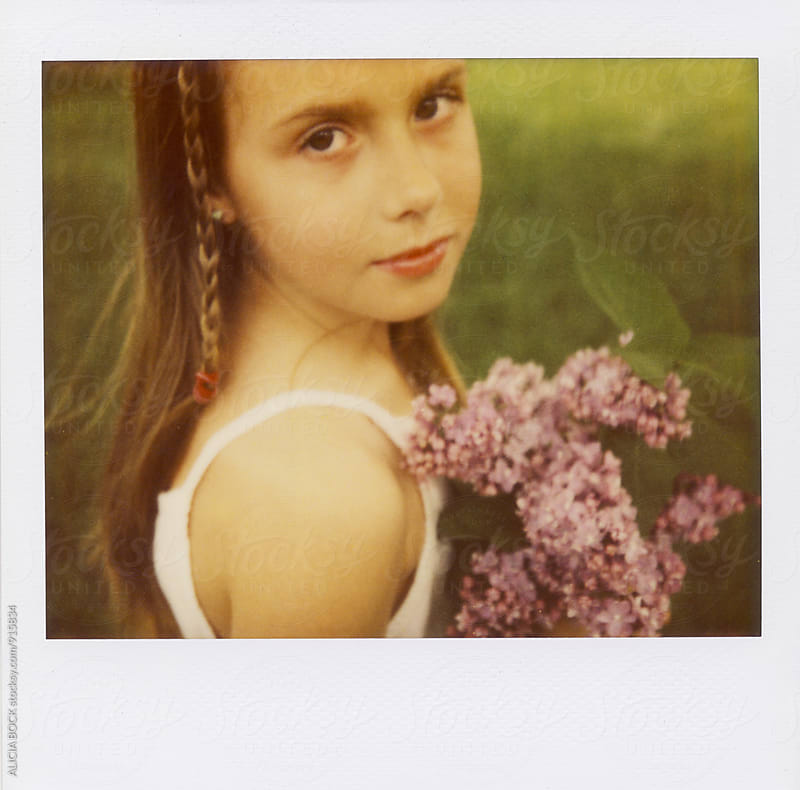 Polaroid Spectra Portrait Of A Girl Holding Fresh Picked Lilac Flowers by ALICIA BOCK for Stocksy United
