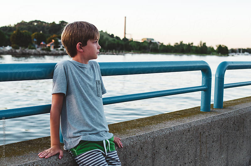 Boy on Pier by Ali Deck for Stocksy United