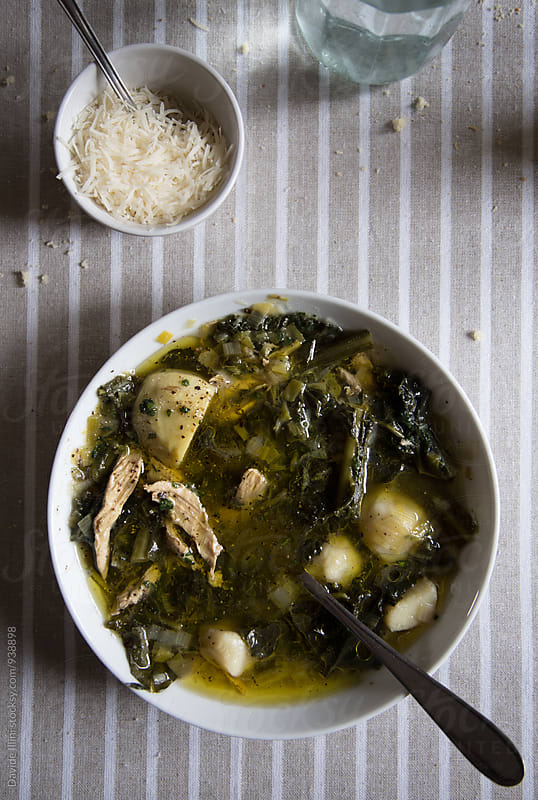 Soup with chicken and mixed vegetables by Davide Illini for Stocksy United