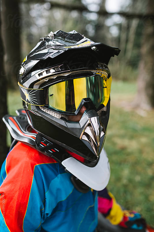 Motocross rider with helmet portrait by GIC for Stocksy United