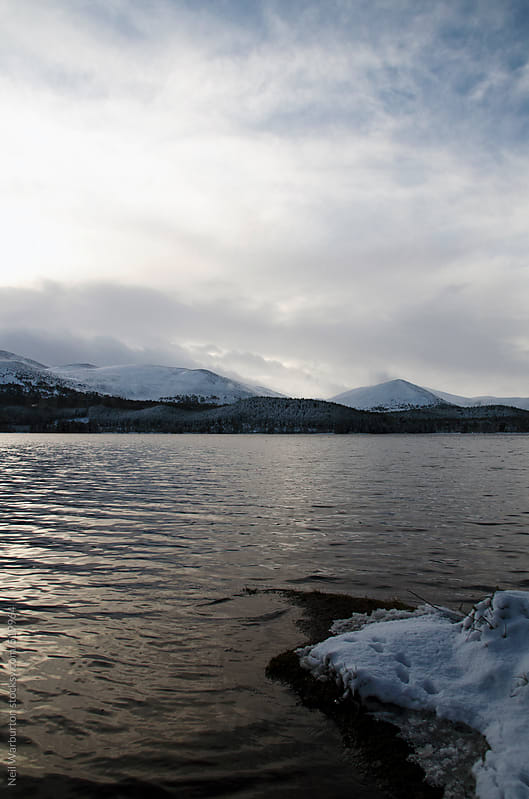 Scottish loch in winter by Neil Warburton for Stocksy United
