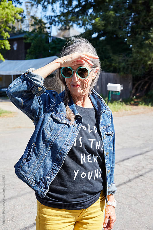 Portrait of stylish senior woman outdoors by Trinette Reed for Stocksy United