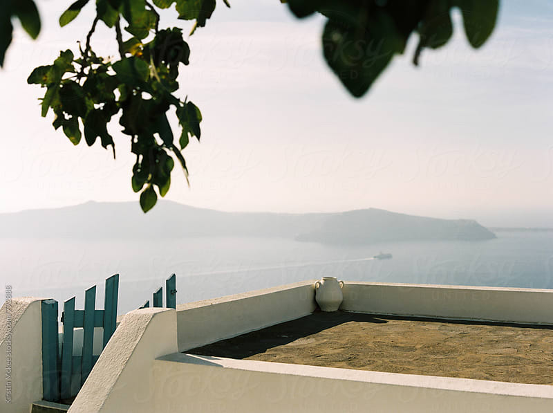 Urn on rooftop of house, Santorini by Kirstin Mckee for Stocksy United