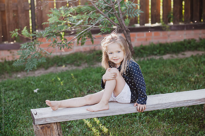 Little girl on the bench by Irina Efremova for Stocksy United