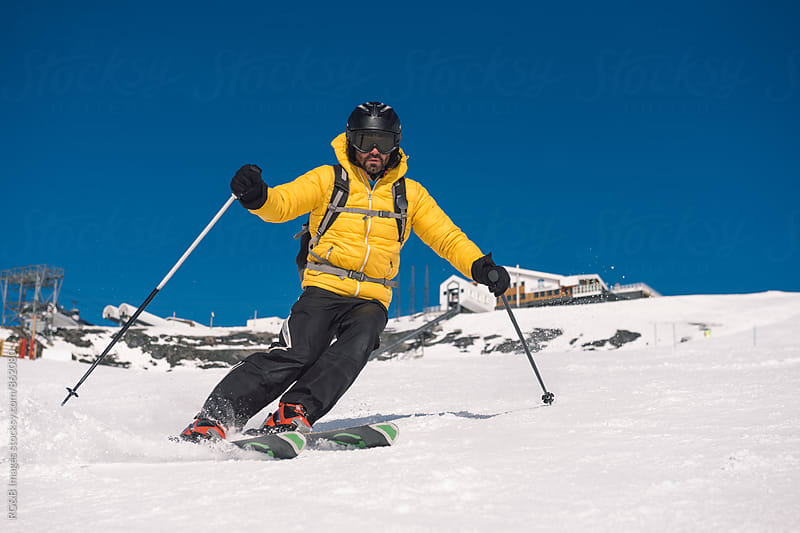 Skier riding down the slope by RG&B Images for Stocksy United