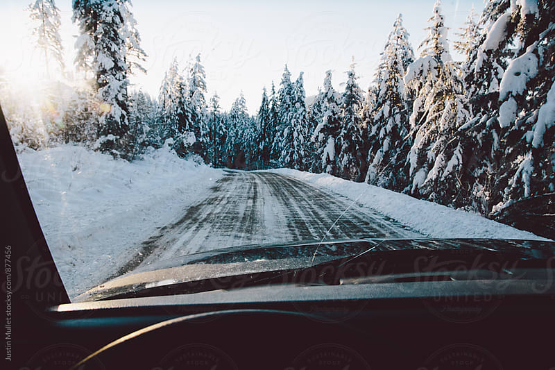 Exploring mountain roads in the winter by Justin Mullet for Stocksy United