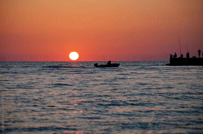 Sunset over the sea by Sveta SH for Stocksy United