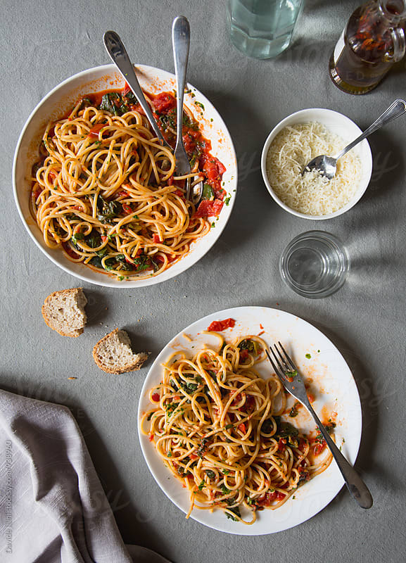 Spaghetti with tomato sauce and fresh spinach by Davide Illini for Stocksy United