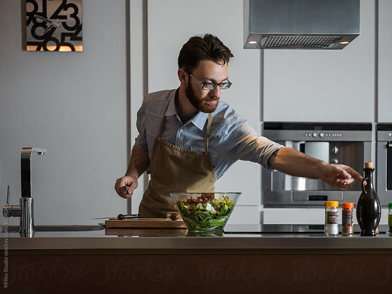 Man cooking salad by Milles Studio for Stocksy United
